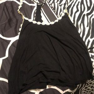 I am selling a black shirt with sun flowers